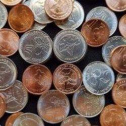 Circulan las nuevas monedas de 1 y 5 pesos